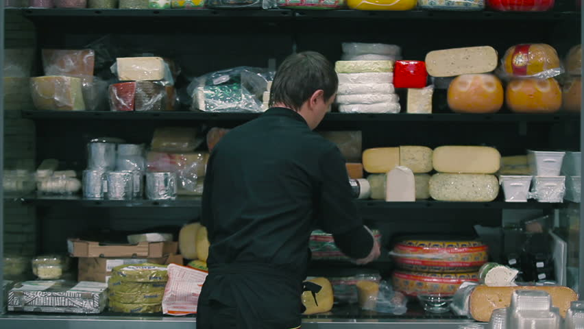 The seller choosing the cheese in the supermarket | Shutterstock HD Video #26489126