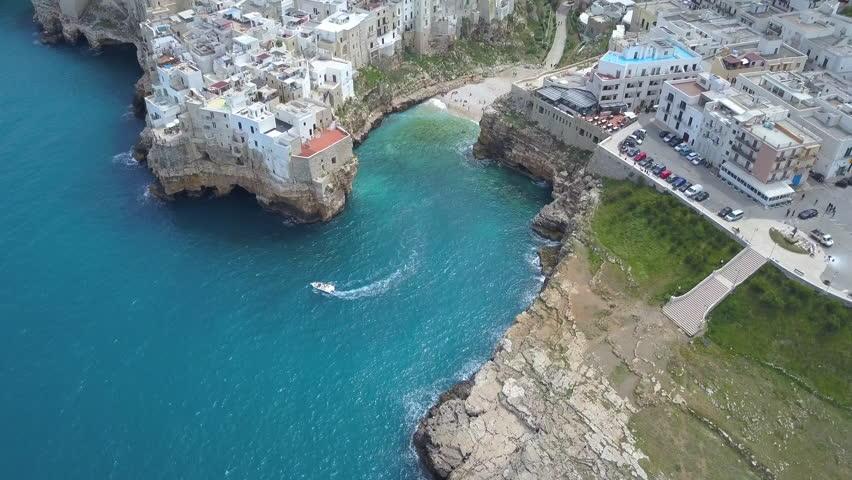 Polignano a Mare (Bari, Italy): heaven on earth. Coastal aerial 4k drone footage video above sea