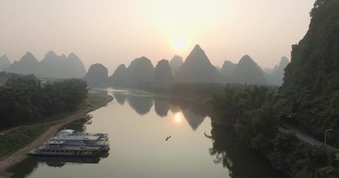 Aerial view of sunrise over landscape of Yangshuo, Guanxi province, Guilin City, China. Li River and karst mountains top view. Travel, adventure and picturesque famous destination concept.