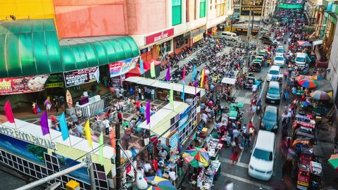 Metro Manila, Philippines - April 23, 2017: Time lapse view over busy street in the Quiapo district of Manila, Philippines.