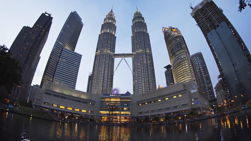 KUALA LUMPUR. MALAYSIA - CIRCA NOV 2016: Kuala Lumpur's Famous Petronas Twin Towers and Other Skyscrapers at Dusk. UltraHD 4k footage