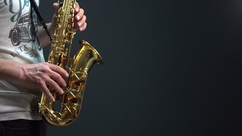 Sax player with black background