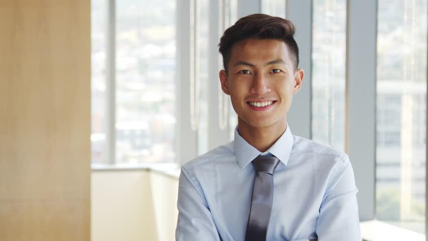 Portrait Of Businessman In Office Walking Towards Camera  | Shutterstock HD Video #26608493