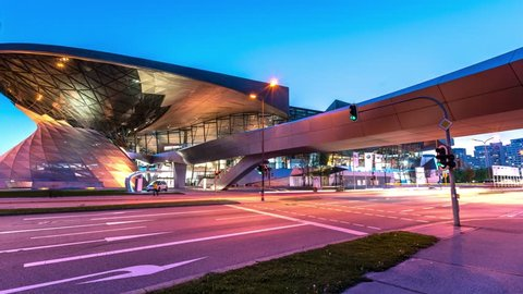 MUNICH, GERMANY - MAI 9, 2016: Hyperlapse video of BMW World (BMW Welt) at night near the Olympicpark in Munich, Germany. Timelapse footage in 4K.
