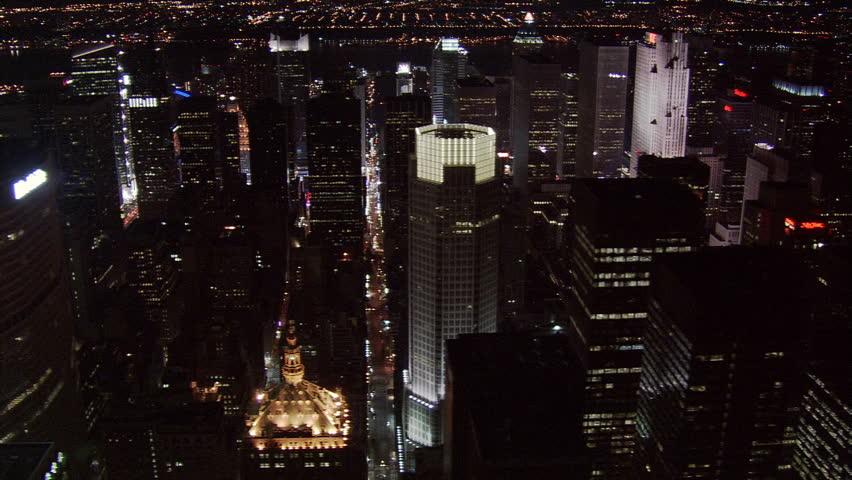 Night flight over midtown Manhattan skyscrapers. Shot in 2005.