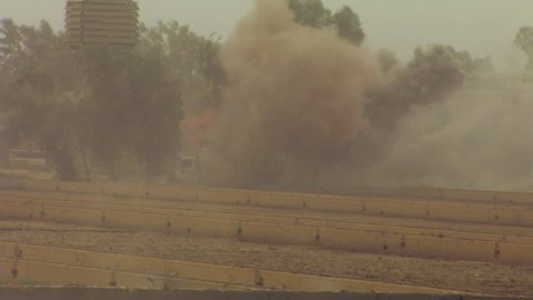 Helicopters circling overhead as explosions rock an Iraqi field