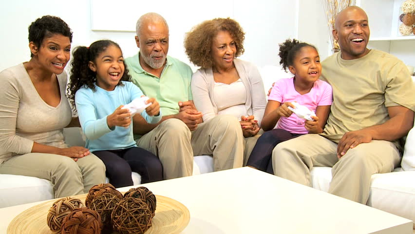 Three Generations Ethnic Family Enjoying Having Fun Interactive Games Console