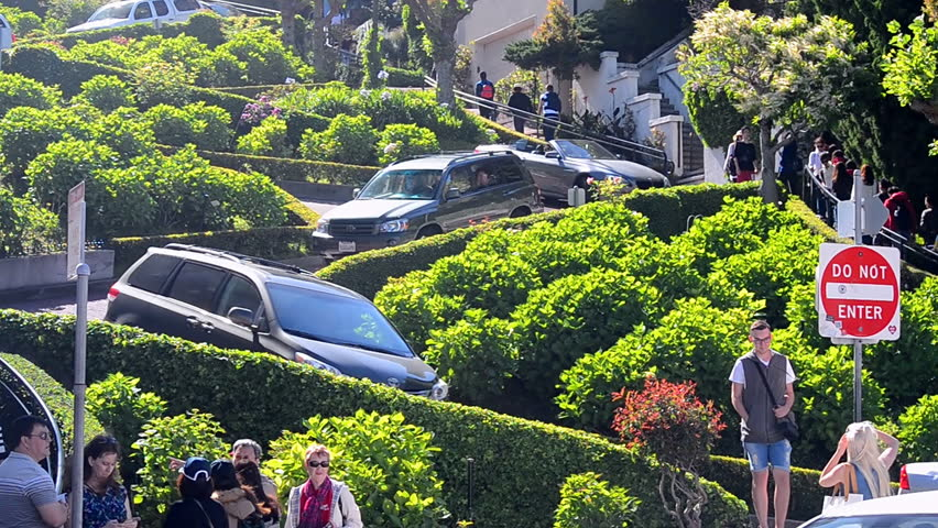 SAN FRANCISCO, USA - APRIL 30: car traffic on famous Lombard Street on April 30, 2017 in San Francisco, USA. It is one-way (downhill) one-block section with eight hairpin turns; paved with red bricks