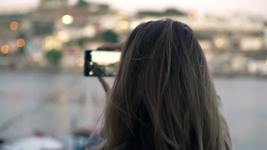Woman taking photos of city view with cellphone in Porto, Portugal  | Shutterstock HD Video #26703763