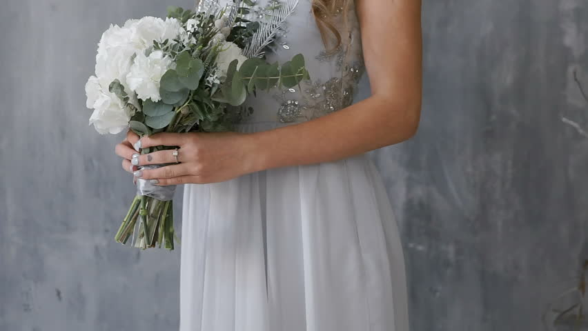 Close-up. The bride is holding a beautiful wedding bouquet. | Shutterstock HD Video #26714659