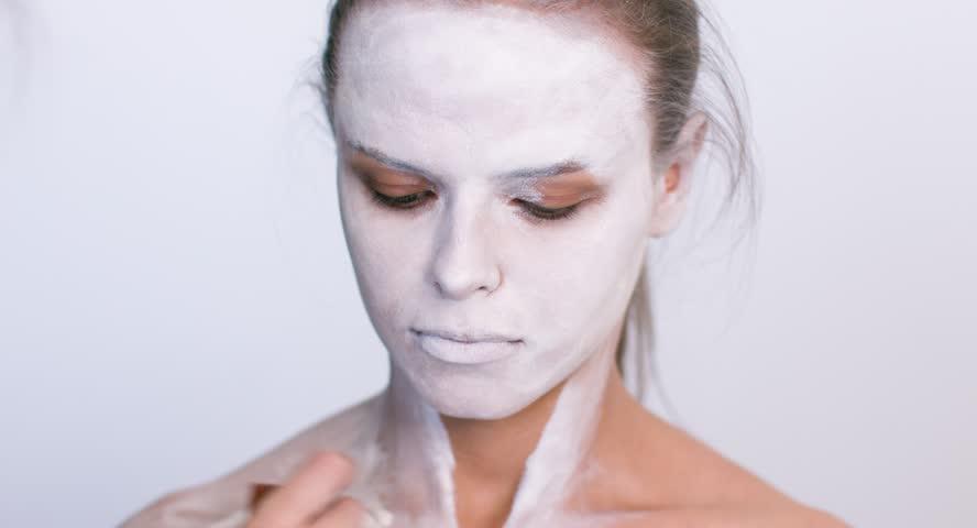 Make-up artist make the girl halloween make up on white background. Halloween face art. | Shutterstock HD Video #26735893