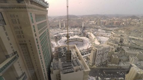 Mecca, Saudi Arabia - September 15, 2016: Time lapse video of Kaaba from a hotel room as the day turn to evening. Muslim believers pray the evening prayer and circle around the Kaabah.