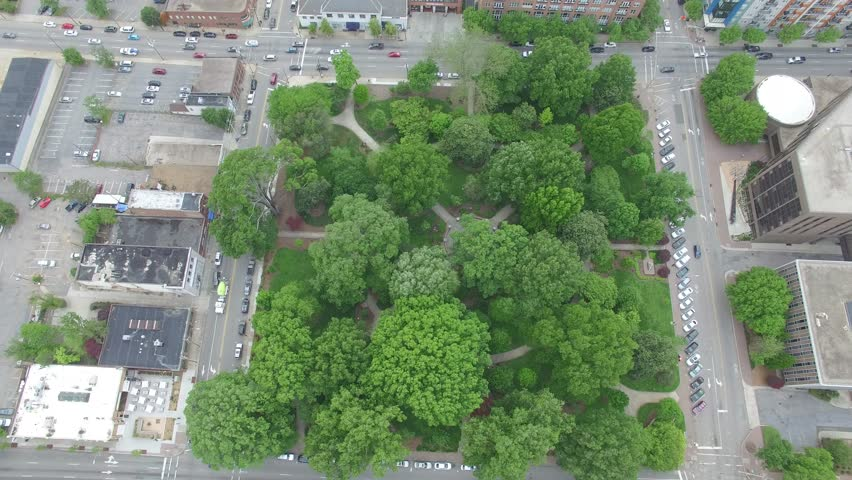Static bird's eye view above Nash Square in downtown Raleigh, NC.  Traffic is slowly moving by the park. | Shutterstock HD Video #26777953