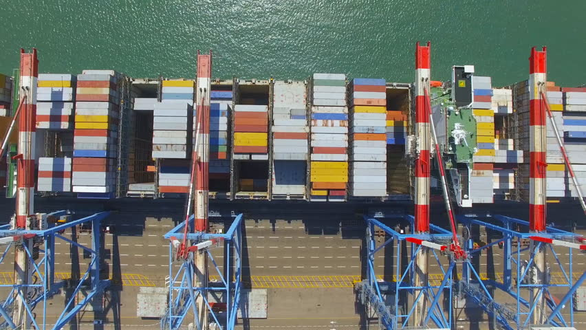 Aerial Time lapse - Commercial port with container ship during loading and unloading - Top down view. | Shutterstock HD Video #26780293