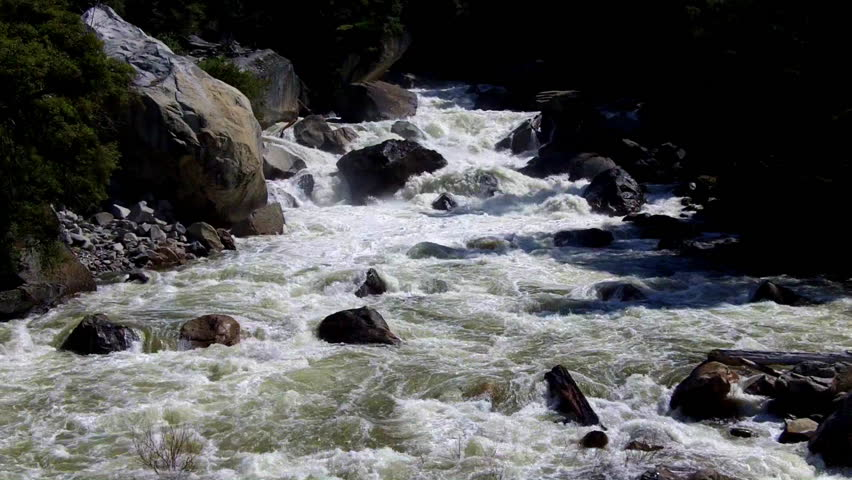 The Merced river in Yosemite Valley with raging whitewater rapids is a favorite