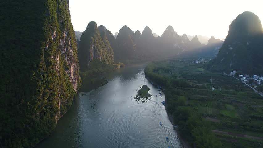 Aerial view of sunset over karst mountain landscape of Yangshuo, Guanxi province, China. Li River and karst mountains top view. Travel, adventure and picturesque famous destination concept