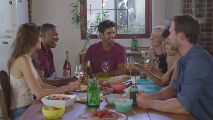 Six young adult friends making a toast at a dinner party, shot on R3D | Shutterstock HD Video #26816053