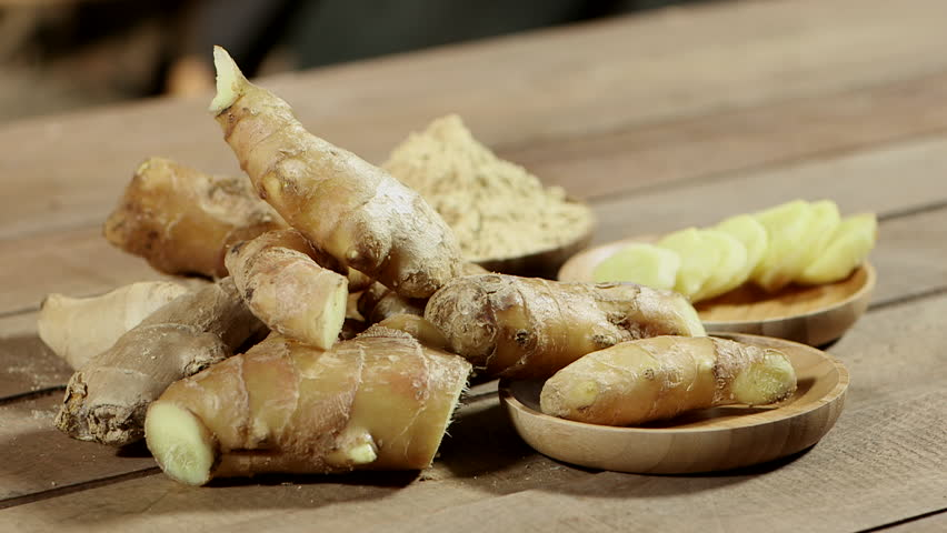 Ginger Slice, Ginger Powder and Ginger Root in Wooden Bowls