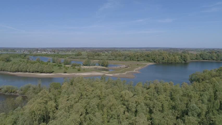 Fly over Dutch landscape at the IJssel river, D-log
