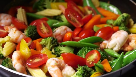 Cooking asian vegetable stir fry and shrimp macro