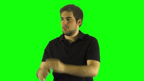 Man With a Old Monocular Looking around with Black T-shirt in front of the Green Screen Standing Up Chroma Key Background Long Time