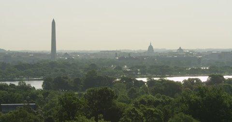 Looking across Potomac River toward DC landmarks in haze, seen from Arlington National Cemetery. Shot in May 2012.