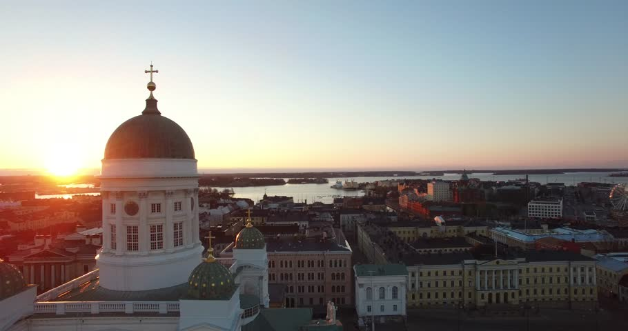Aerial view drone footage of Helsinki old cathedral and central square area near city center and harbour market square with city skyline and Baltic Sea view in the capital of Finland, northern Europe
