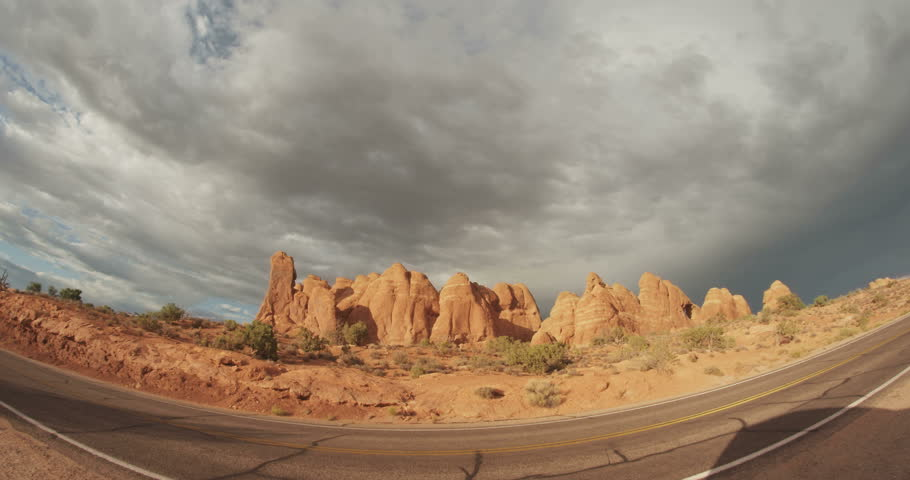 Fisheye storm clouds above red rock in Arches National PArk - Moab, UT 4K