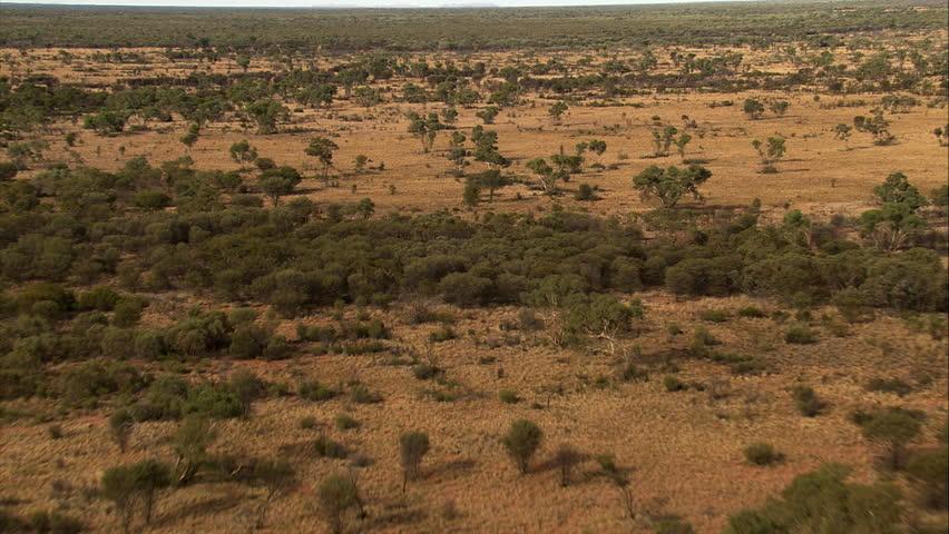 Over mulga scrubland in Northern Australia west of Alice Springs