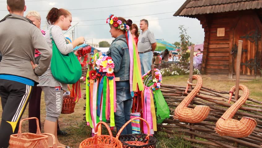 VELYKI SOROCHYNTSI, UKRAINE - AUGUST 17: People shop at the Sorochyntsy Fair on August 17, 2012 in Velyki Sorochyntsi, Ukraine. This large fair has been held every year since the end of Soviet rule and was declared Ukraine's national trade fair.