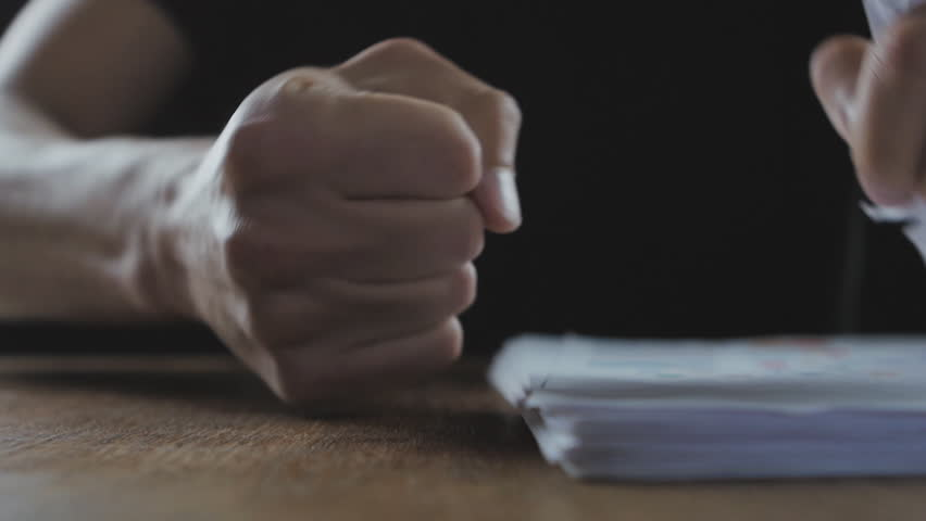 Angry boss beats his fist on the table. Threat of violence. The boss shows aggression. | Shutterstock HD Video #26976811