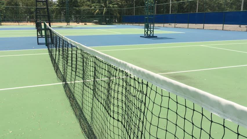 4K footage.Close-up shot of a tennis Net at an Outdoor Court. tennis net sways at outdoor tennis court. | Shutterstock HD Video #27011923