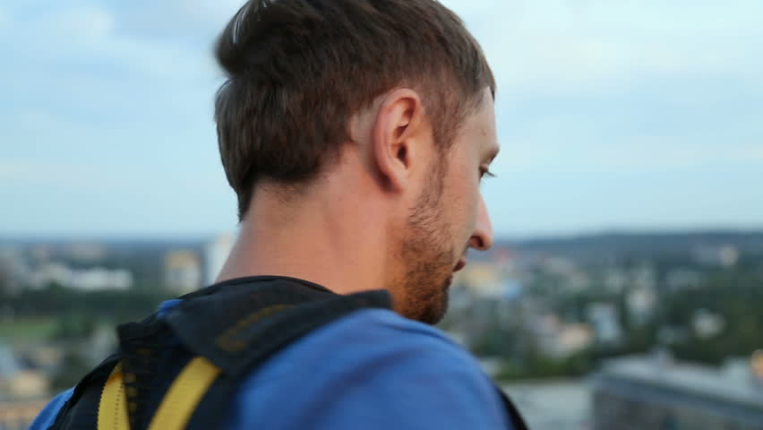 Extreme young man preparing to jump down from huge heights, bungee jumping | Shutterstock HD Video #27023713