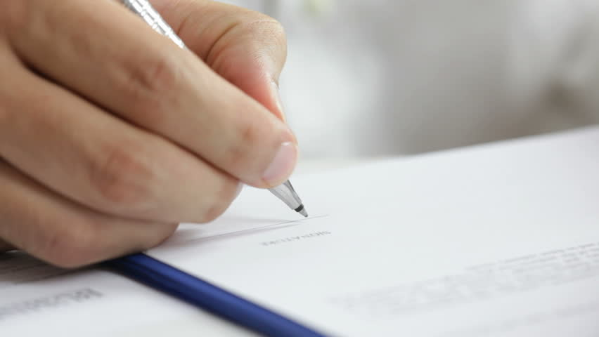 Businessman signing a contract. Signature is fake | Shutterstock Video #2703713
