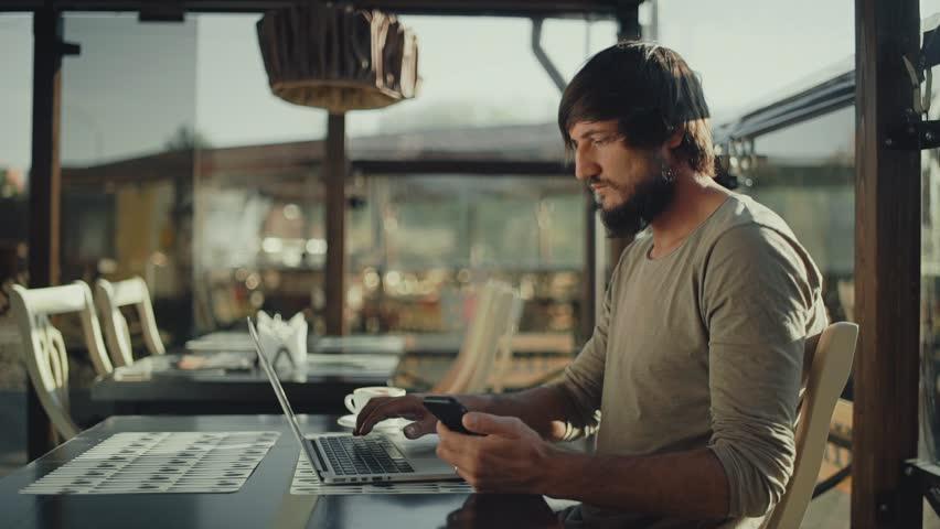 Bearded freelancer Man typing on laptop   Shutterstock HD Video #27045763