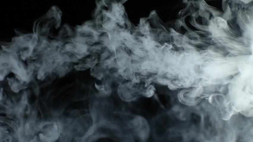 Vapor Like Smoke On A Dark Black Background. Vape Smoke Rings In Motion At Vape Clouds. Stock ...