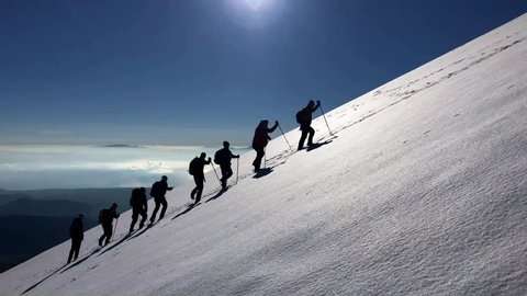 hiking group in snowy mountains