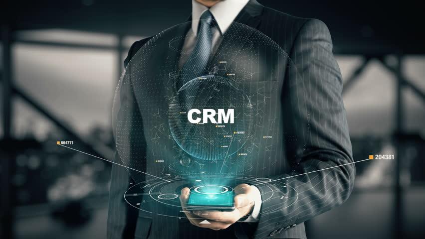 Businessman with CRM hologram concept