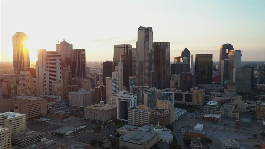 4K Aerial shot of Dallas downtown Skyline sunset pan move