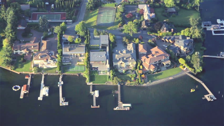 Overhead right pan across luxurious estates, yards and yachts on lakefront property