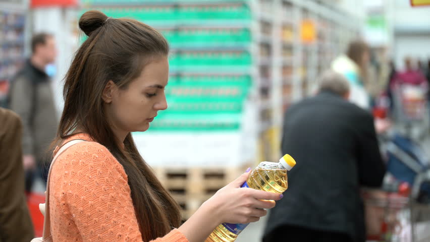 Woman buys sunflower oil in the store | Shutterstock HD Video #27092713