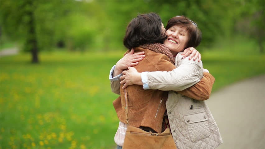 Meeting Adult Daughter and Her Mother in the Park. Attractive Brunette is Hugging Her Mom with Love and Tenderness. | Shutterstock HD Video #27126823