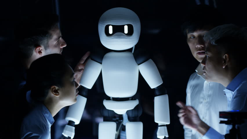 4K Electronics engineers collaborating on design of robot in dark lab | Shutterstock HD Video #27164893