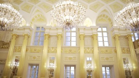 The palace with golden columns and chandeliers.