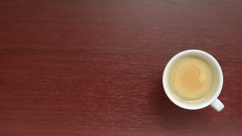 Coffee. Cup coffee with copy space. A cup of fragrant coffee on a wooden table.  Background coffee.  Space for text.