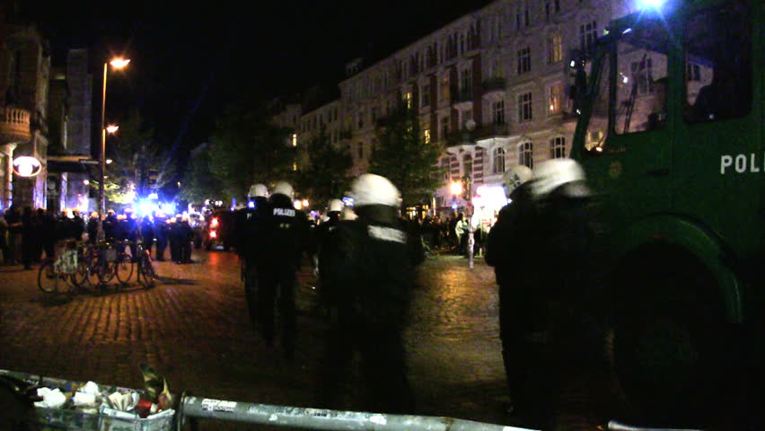 HAMBURG - CIRCA AUGUST 2012: Police operation circa August 2012 in the Schanzenviertel neighborhood of Hamburg, Germany. The peaceful Schanzenfest event ended in riots at night.