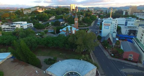 Aerial drone video of capital Windhoek upmarket Luxury Hill area near Independence Avenue with view of historical castles  city skyline in central highland Khomas Hochland of Namibia, southern Africa