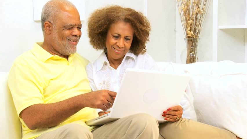 Senior African American couple laptop computer home