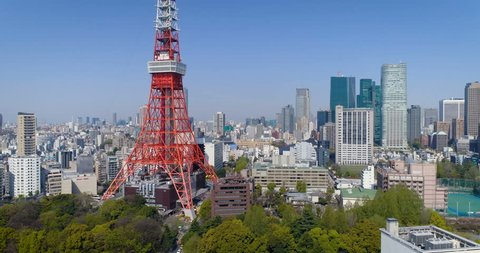 TOKYO - APRIL, 2017 : Aerial elevated shot of Tokyo tower and city skyline with downtown buildings, Japan. Tower is inspired by an Eiffel Tower and is second tallest structure in Japan.