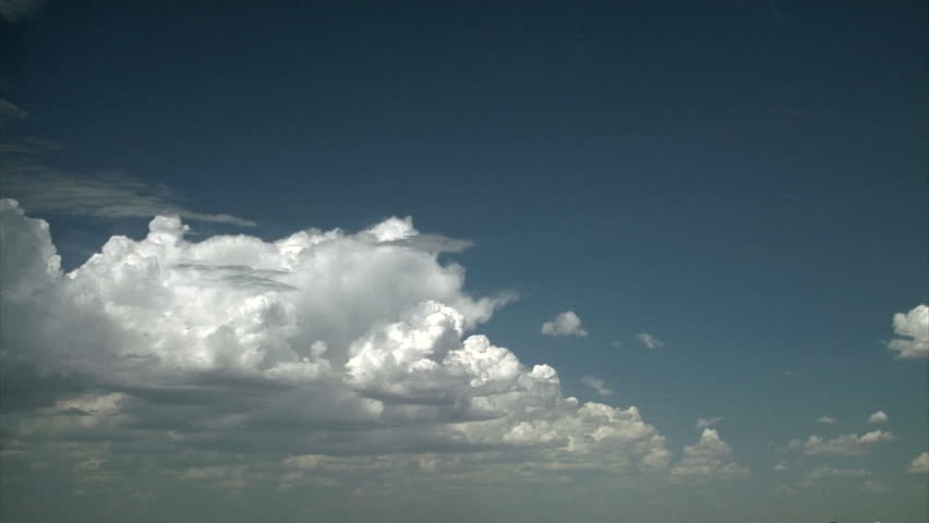 clouds forming and covering sky